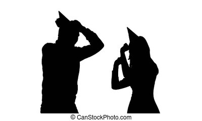 Guy and the girl in hats dancing at a party to the birthday. White background. Silhouette