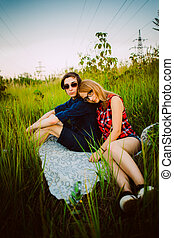 guy and the girl sitting in the grass
