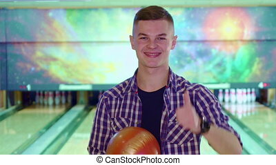 Guy approves bowling - Brunette guy approving bowling by...