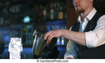 Guy-bartender shows the tricks - The bartender shows the...