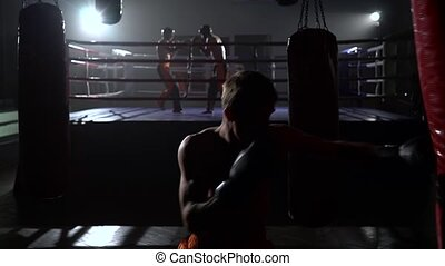 Guy beats a pear, in the background in the ring goes...