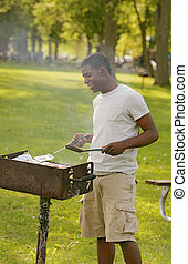 guy cooking bbq