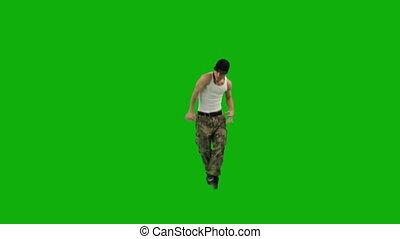 A guy dancing hip-hop against green screen
