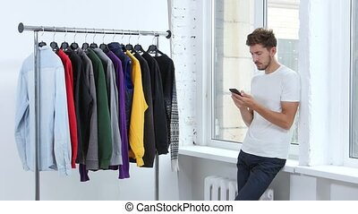 Guy dials on the phone message, he is cold, he wants to wear...