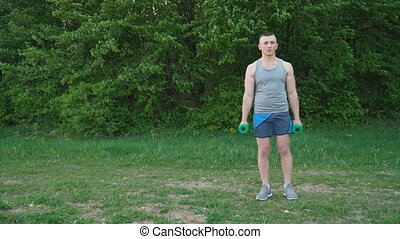 Guy exercising with dumbbells