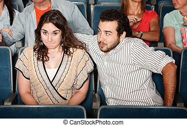 Guy Flirting in Theater - Guy in beard flirts with young...
