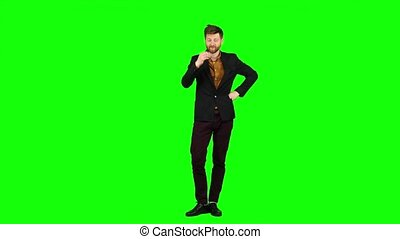 Guy flirts, he smiles and builds his eyes. Green screen -...