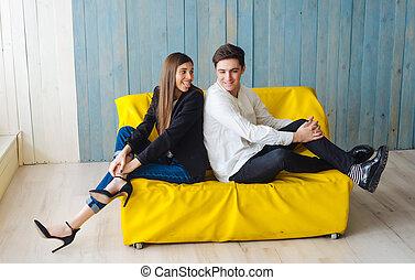 guy girl on the yellow sofa