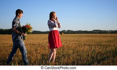 guy gives a bouquet of flowers to the girl