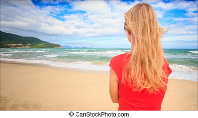 Guy Gives Gift to Blond Girl in Red Kiss Hug on Beach
