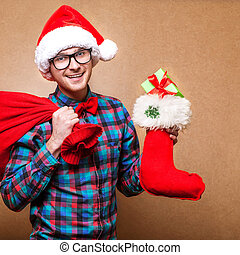 Guy holding a gift and emotionally happy Christmas