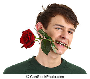 Guy holding a red rose in his mouth
