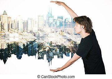 Guy holding abstract city