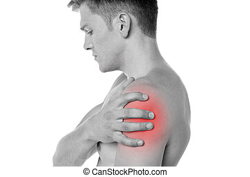 Guy holding his shoulder in pain - Young man having shoulder...