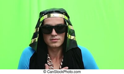 Guy in Egyptian costume on a green background - Guy in...