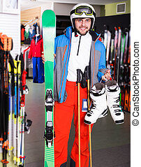 Guy in skiing outfit in shop