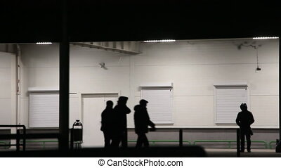 Guy in the hood stands at night near wall - The guy in the...