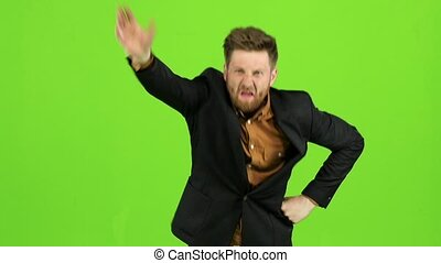 Guy in the suit got angry and started shouting loudly. Green screen. Slow motion