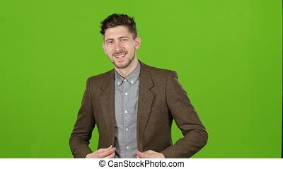Guy is a businessman, is showing his finger up, admires. Green screen