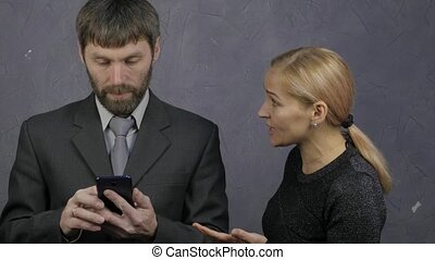 guy is browsing the phone, woman snatches his phone and...