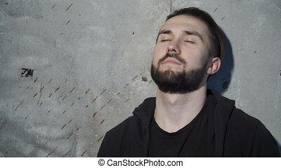 Guy is closing his eyes