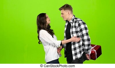 Guy is standing and waiting for his beloved girl with a gift. Green screen