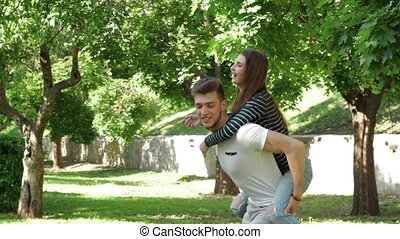Guy is the girl on the back and laughing in the Park