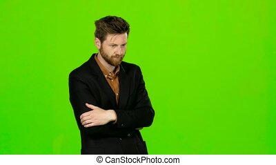 Guy is very tired and thoughtful, reflects on life. Green screen