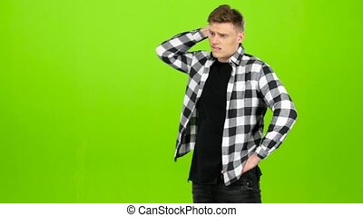 Guy is waiting for his girlfriend she comes and gently kisses him. Green screen