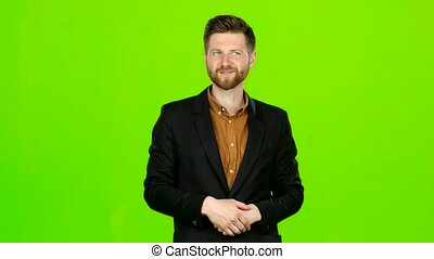 Guy jokes, he is not bored, he is happy and positive. Green screen
