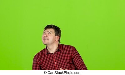 Guy in the shirt looks up and selects the option he needs. Green screen