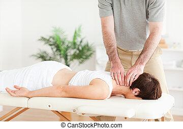 Guy massaging a brunette woman's neck