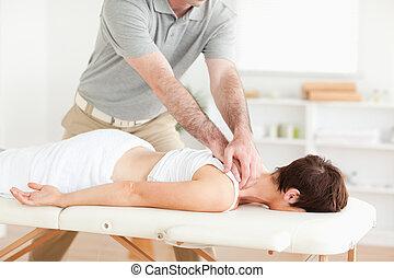 Guy massaging a cute woman's neck