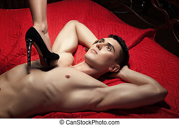 Guy on the chest is female foot in shoe heel. - The guy on...