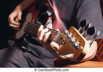guy playing bass