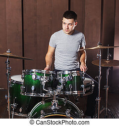 Guy playing the drums
