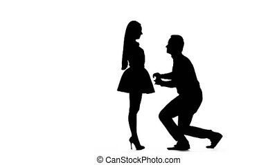 Guy proposes to marry the girl, she says yes. Silhouette. White background