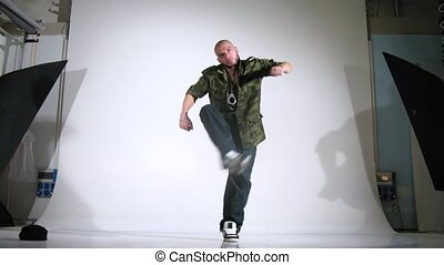Guy-rapper poses for photographer in studio