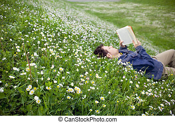 Guy-reading-02 - guy laying on the grass and reading a book