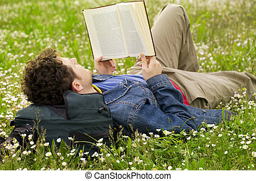 Guy reading 03 - guy laying on the grass and reading a book