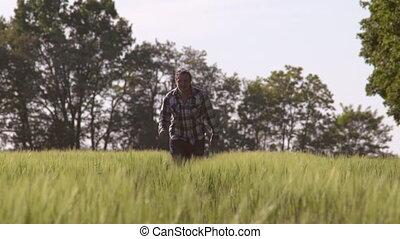 Guy runs outdoor around green nature