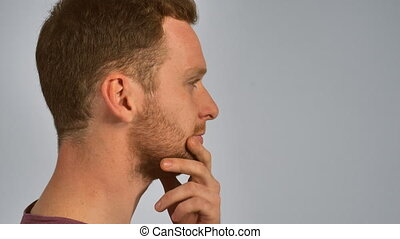 guy showing hand gesture have idea - portrait pensive young...