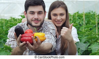 Guy shows healthy vegetables and the girl thumbs up