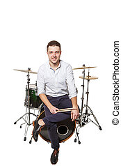 Guy sitting on the drums