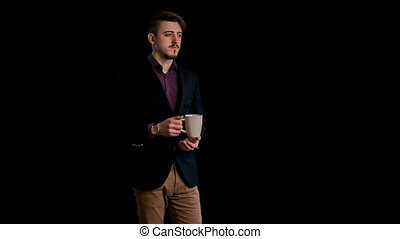 guy standing with a cup