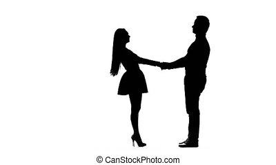 Guy takes the girl in his arms and kisses. Silhouette. White...