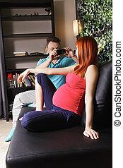 Guy taking photo of pregnant woman