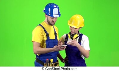 Guy the builder shows the schedule in phone. Green screen....
