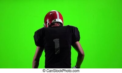 Guy throwing a football and running. Slow movement, Green screen
