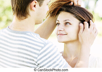 Guy touching girlfriends hair